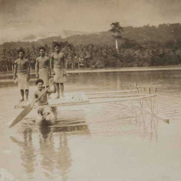 Group on canoe from: Photograph album: scenes from British Solomon Islands Protectorate, ca 1939–1949<br />