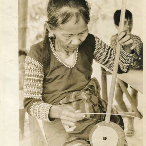 A Bilaan woman playing a single string fiddle<br />